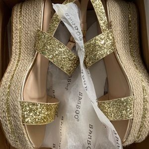 Never worn- gold platform sandals
